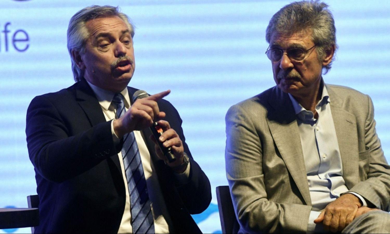 Alberto Fernández y Hugo Sigman
